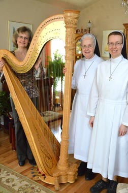 Harpist Gianetta Baril and Srs. Gilberte Baril and Judith Giroux encouraged Alberta Catholics to adopt the practice of Eucharistic Adoration.
