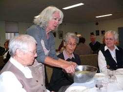 Netta Phillet serves bietzah, a hard-boiled egg, to three Grey Nuns – Sisters Dora Durand, Marguerite Letourneau and Evelyn Gagnon.