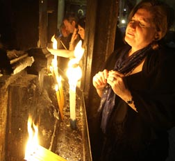 Christians pray near candles at the Church of the Holy Sepulchre.