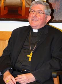Cardinal Thomas Collins talks with local media April 13 during his two-day visit to Edmonton.