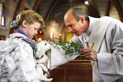 A deacon blesses a dog in the Netherlands, just one example of the many roles deacons can play.
