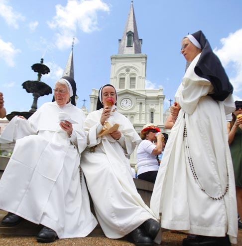 With St. Louis Cathedral in the background, Dominican nuns enjoy ice cream during the annual French Quarter Festival in New Orleans April 14. More than 500,000 people packed the French Quarter for the three-day event.