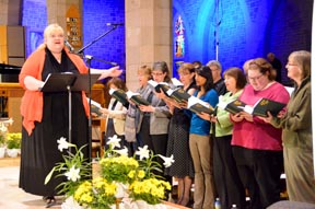 Karen Koester directs the Nothing More Beautiful Choir and leads the congregation in singing at the April 19 secession of Nothing More Beautiful.