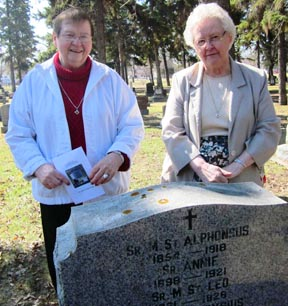 Srs. Deana Kohlman and Norma Johnson remember sisters buried in St. Joachim Cemetery.