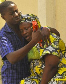 Relatives of victims of a gun attack mourn at a hospital in Nigeria's northern city of Kano April 29.