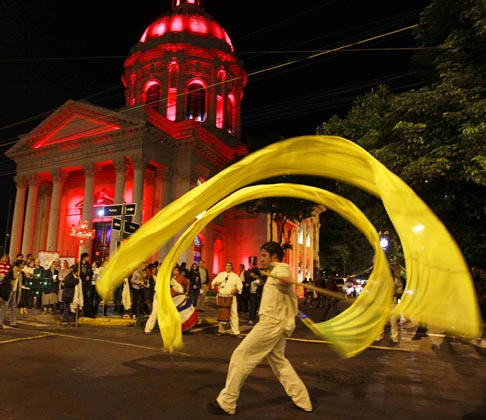 Actors from the group Hara perform in front of the National Pantheon of The Heroes before a procession on the eve of Kurusu Ara, or the Day of the Cross, in Asuncion, Paraguay, May 2. Kurusu Ara, a Catholic religious festival that is combined with local Guarani cultures, is celebrated annually May 3.