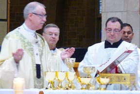 Archbishop Richard Smith, assisted by Ukrainian Bishop David Motiuk and Fr. Paul Kavanagh at the annual Mass for Life May 17.
