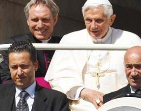 Paolo Gabriele is seated at the left, front as the pontiff arrives in St. Peter's Square May 2.