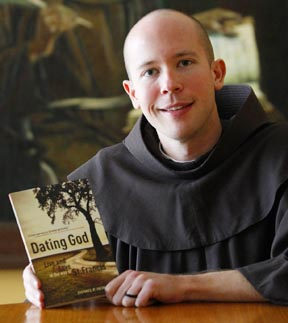 Franciscan Brother Daniel Horan holds a copy of his book, Dating God: Live and Love in the Way of St. Francis.