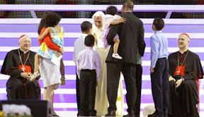 Pope Benedict greets a family during the closing Mass for the World Meeting of Families at Milan's Bresso Park June 3.