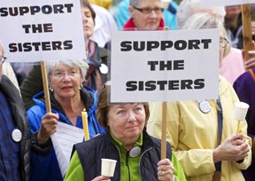 Supporters of the Leadership Conference of Women Religious take part in a vigil outside St. James Cathedral in Seattle May 8 to oppose the Vatican's call for a reform of the LCWR.