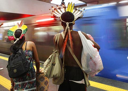 An indigenous couple waits for the train as they make their way to the People's Summit in Rio de Janeiro June 20. The summit was a parallel event of the June 20-22  UN Rio+20 Conference on Sustainable Development.