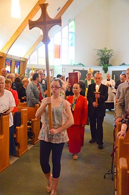 Parishioners lead the way in the entrance processional