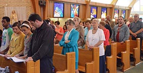 Parishioners of St. Pius X Parish take part in their last Sunday Eucharist July 1.