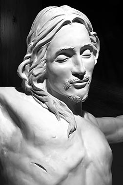 Gregory Furmanczyk provides a traditional depiction of Jesus in the crucifix he has sculpted for the Newman Theological College chapel.