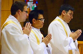 Deacons Matthew Hysell, Luan Dinh Vu and Carlos Nunez take part in the Mass after their ordinations to the diaconate at St. Joseph's Basilica Aug. 27.