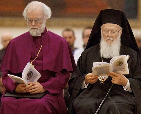 Archbishop Rowan Williams of Canterbury, spiritual head of the Anglican Communion, and Ecumenical Patriarch Bartholomew of Constantinople will join Pope Benedict's celebration of the 50th anniversary of the opening of the Second Vatican Council. The two Church leaders are pictured in a 2011 photo in Assisi, Italy. Representatives from the Orthodox Church and Anglican Communion were observers at the 1962-65 council, which officially embraced and promoted Catholic involvement in the ecumenical movement.