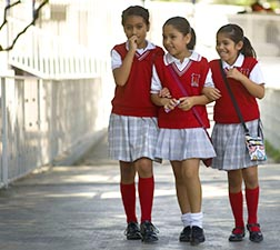 Students walk together during recess at Miguel Hidalgo elementary school in Tijuana, Mexico, Sept. 13.