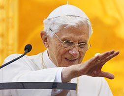 Pope Benedict waves after praying the Angelus at the papal villa at Castel Gandolfo, Italy, Sept. 30.