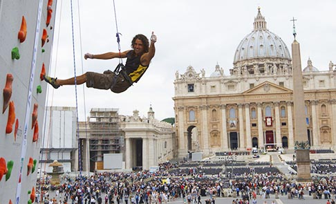 A climber gives a thumbs-up as he descends during a climbing exhibition held outside St. Peter's Square at the Vatican Oct. 7.