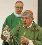 Cardinal Thomas Collins of Toronto uses incense as he celebrates a Mass to take possession of his titular church of St. Patrick in Rome Oct. 23.