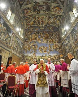 Pope Benedict gives a blessing after a service to mark the 500th anniversary of Michelangelo's completion of the Sistine Chapel ceiling paintings.