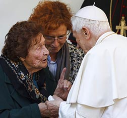 Pope Benedict talks with Enrichetta Vitali, 91, during a visit Nov. 12 to a home for the elderly in Rome.