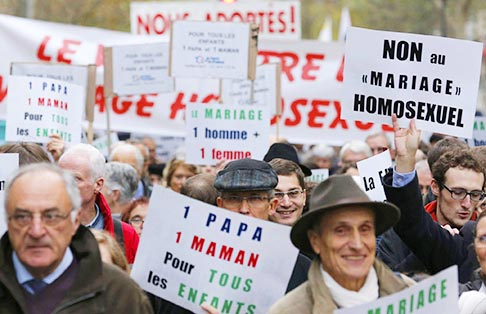 Opponents of same-sex marriage demonstrate in Paris Nov. 18 against the French government's draft law to legalize marriage and adoption for same-sex couples. Catholics are called to serve the common good of society, including by protecting traditional marriage and defending human life, Pope Benedict told bishops from France.