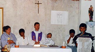 A young Fr. Paul Paul Terrio celebrates  a parish  Mass during his years in Brazil.