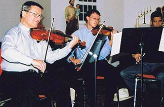 Fr. Paul Terrio played his part in the Villeneuve parish string quartet.