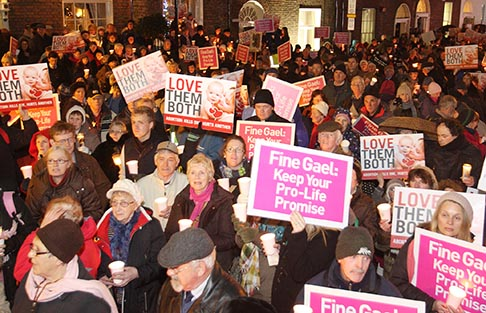Pro-life demonstrators hold signs during a candlelight vigil outside the Irish parliament in Dublin Dec. 4, calling on the government not to introduce abortion legislation. A crowd estimated at 8,000 gathered to call on Irish Prime Minister Enda Kenny to keep a pledge made in 2011 not to introduce abortion legislation.