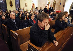 Mourners gather inside St. Rose of Lima Church for a vigil service in Newtown, Conn., Dec. 14.