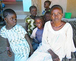 Constance Mbaye sits with children in the village of Dialamakhan,  Senegal. Mbaye works to help rural women get an education.