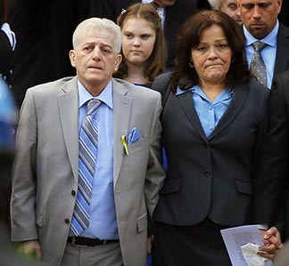 Patty Campbell walks out of the April 22 funeral Mass for her daughter, Krystle Campbell, with her son Billy, right, at her side at St. Joseph Church in Medford, Mass. Krystle was one of three people killed when bombs exploded in the crowded streets near the finish line of the Boston Marathon.