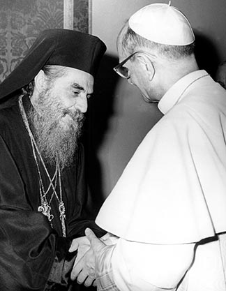 Pope Paul VI, right, greets Orthodox Ecumenical Patriarch Athenagoras of Constantinople during the pontiff's 1964 trip to the Holy Land.