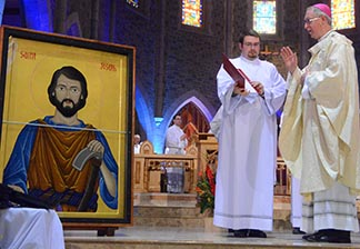 At a May 1 Mass at St. Joseph's Basilica Archbishop Richard Smith blesses the icon of St. Joseph the Worker written to commemorate the 100th anniversary of the Edmonton Archdiocese.