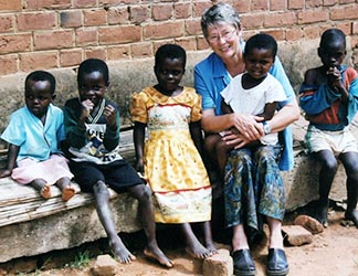 Scarboro Missions' Mary Olenick enjoys her small charges in Malawi.