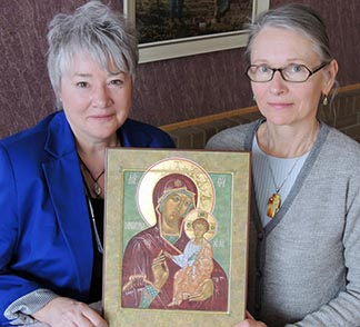 Gisele Bauche and Anna Mycyk display a completed icon.