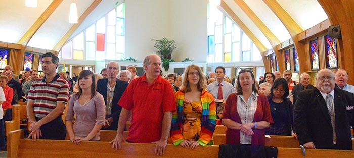 A solemn congregation gathered for the final Mass at St. Pius Church on Canada Day 2012.