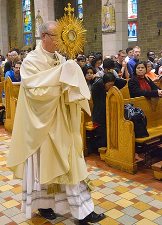 Archbishop Richard Smith leads an Indoor Corpus Christi June 7 at St. Joseph's Basilica in Edmonton.