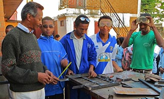 A Catholic social service agency provides metal work training for men forced off their land.