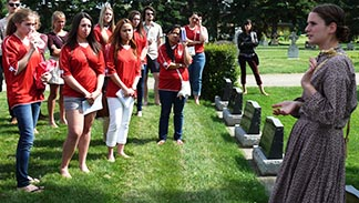 Local World Youth Day pilgrims listen to a presentation at the grave of Venerable Anthony Kowalczyk.