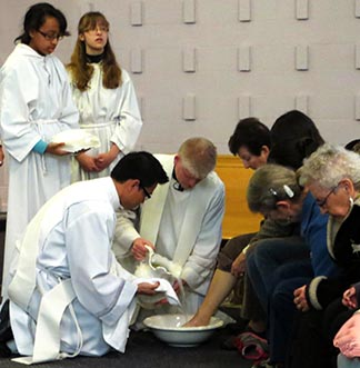 Fr. Patrick Baska replicated Jesus' washing of his apostles' feet at St. Angela's Church on Holy Thursday.