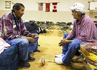 Winston and Noel Maquire at the Siksika Nation evacuation shelter, worry about their homes.