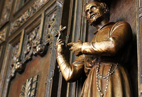 A statue of St. Isaac Jogues, one of the Canadian Martyrs, is seen on one of the two restored bronze doors at the main entrance of St. Patrick's Cathedral in New York following their installation Aug. 14. The doors each weigh nearly five tons. The installation marked a major milestone in the three-year, $177-million restoration of the cathedral.