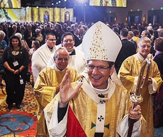 San Antonio Archbishop Gustavo Garcia-Siller greets Knights of Columbus and their family members during the Catholic organization's annual convention Aug. 6 in San Antonio.