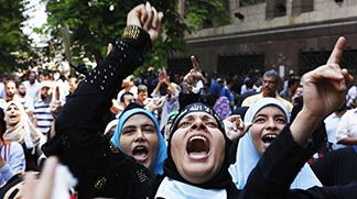 Supporters of ousted Egyptian President Mohammed Morsi take part in a protest near Ennour Mosque in Cairo Aug. 16.