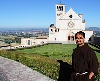 Bro. Carlos Ona stands before the Basilica of St. Francis in Assisi, Italy, during a retreat prior to making his solemn vows.