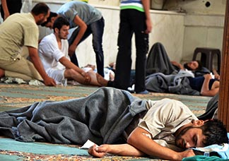 People rest in a mosque ill, from a gas attack carried out in Damascus Aug 21. The gas attack killed hundreds of people.