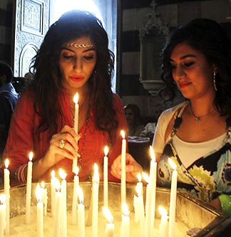 Syrian women light candles before attending a prayer service at the Melkite Catholic patriarchate in Damascus, Syria, Sept. 7. People worldwide heeded Pope Francis' call for a day of prayer and fasting for peace in Syria.